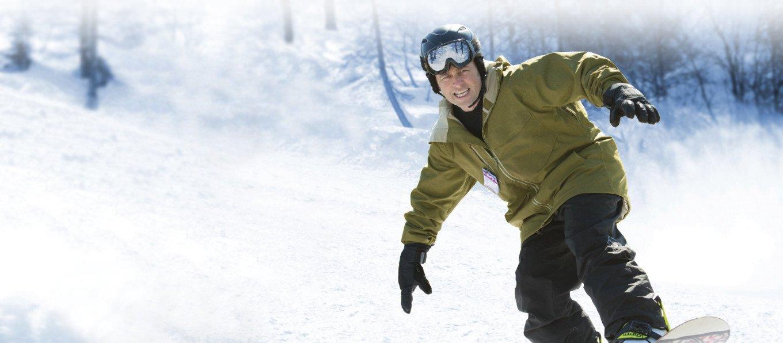 Man Snowboarding After Having Knee Surgery